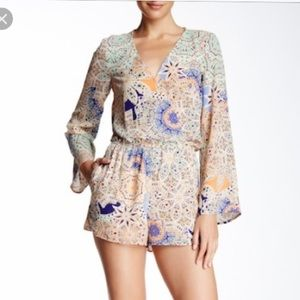 Crochet detail romper with bell sleeves